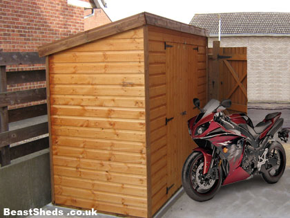 motorbike shed with motorbike